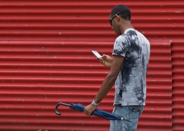 153777309-man-uses-his-mobile-phone-in-a-street-of-havana-cuba-on.jpg.CROP.promo-mediumlarge